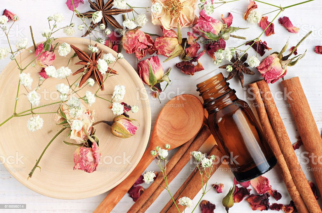 Essential oil blend of rose, cinnamon, anise stock photo