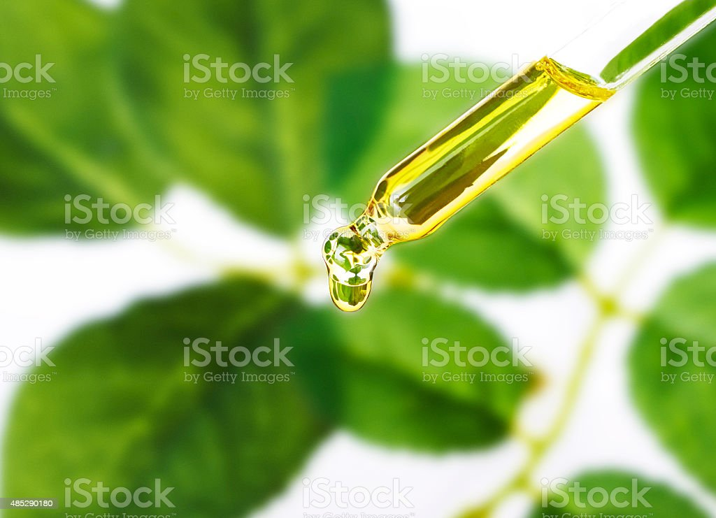 Essential oil dropping from pipette .Aromatherapy.perfume. stock photo