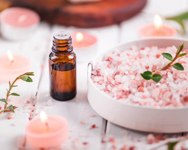 Essential oil for aromatherapy, flowers, handmade soap, himalayan salt. stock photo