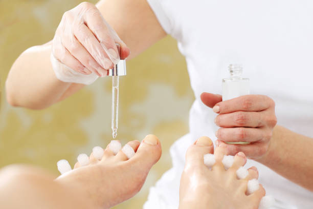 Essential oil for skin care, beautiful feet. stock photo