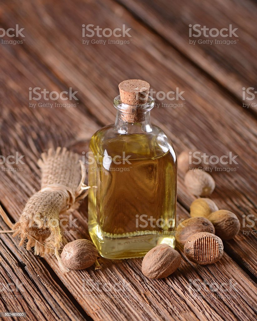 essential oil of nutmeg stock photo