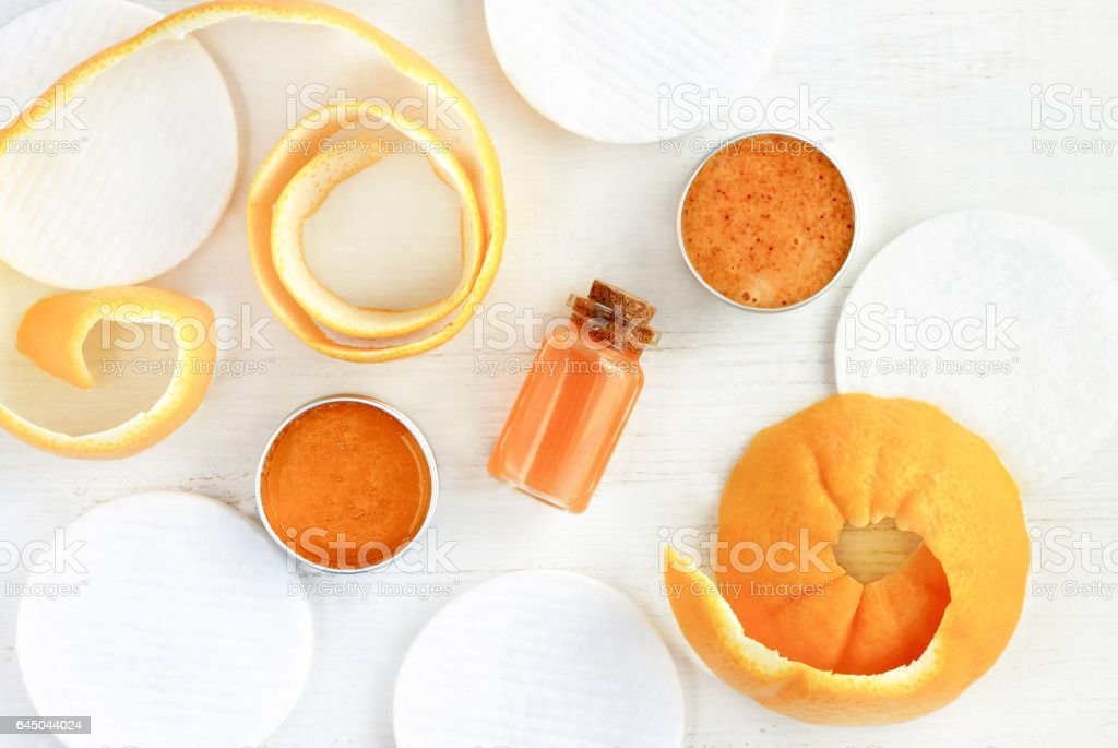 Essential oil of orange, fruit peel, facial scrub stock photo