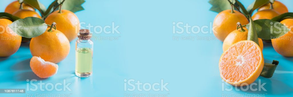 Essential Oil Of Orange Mandarin In Glass Bottle Over Blue Background Skincare Concept Stock Photo Download Image Now Istock