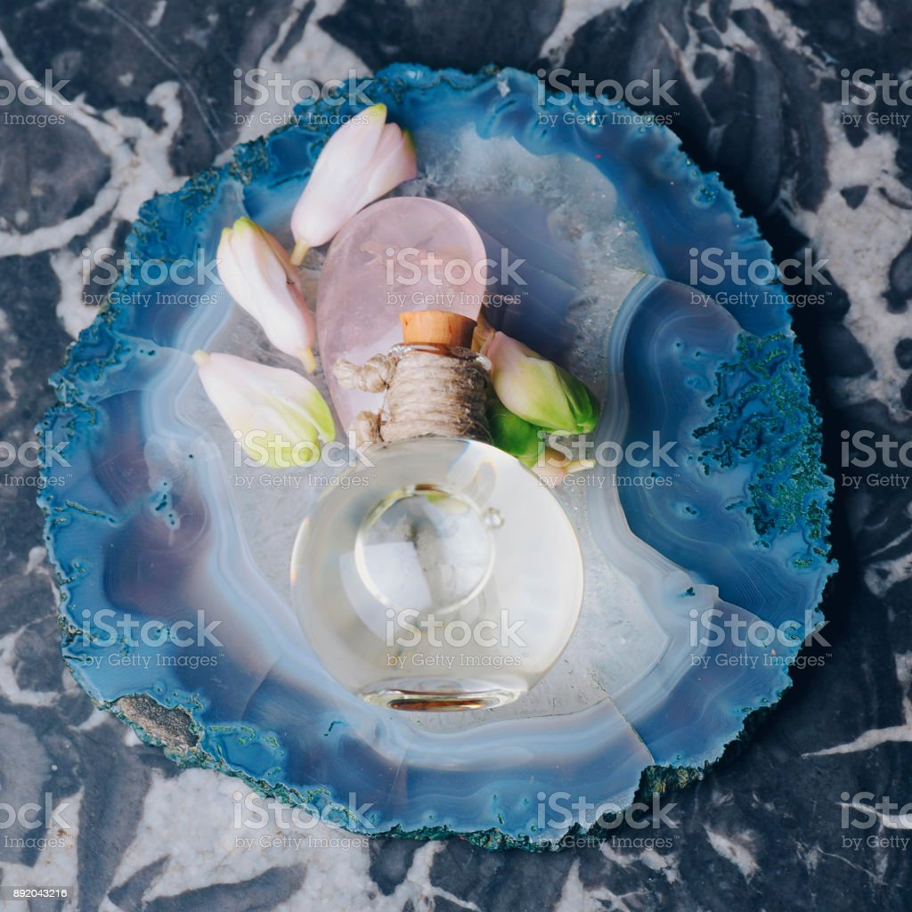 Essential Oil with flower and stones stock photo
