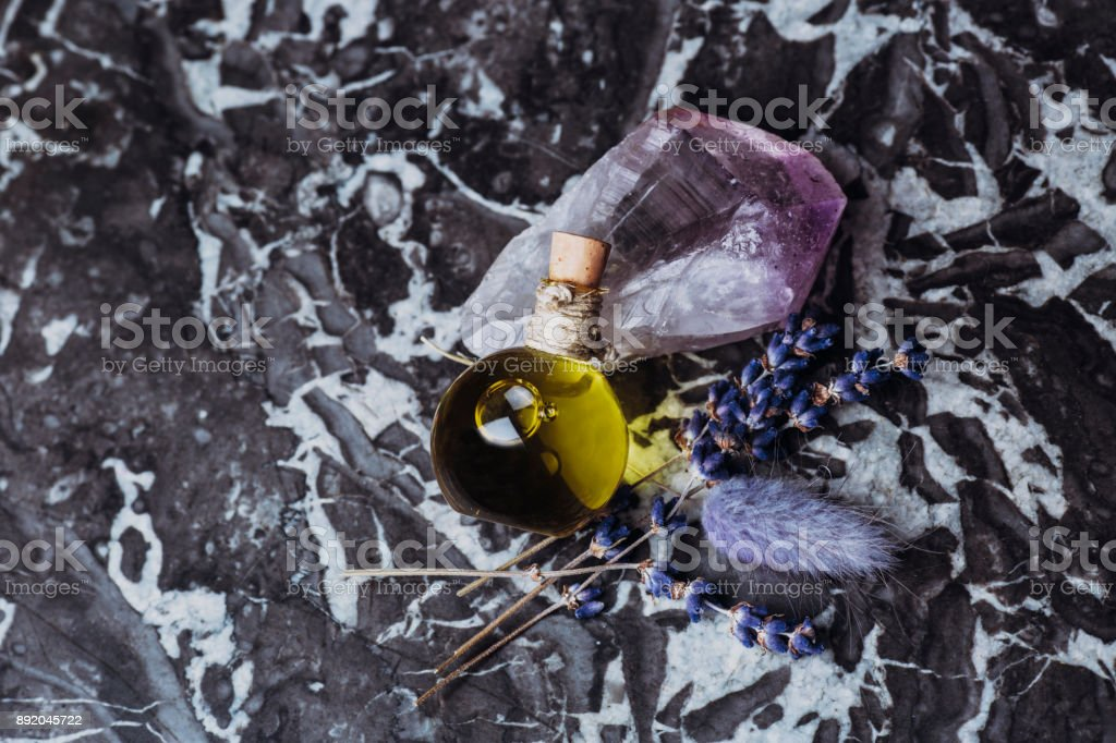 Essential oil with quartz stone, lavander and marble stock photo