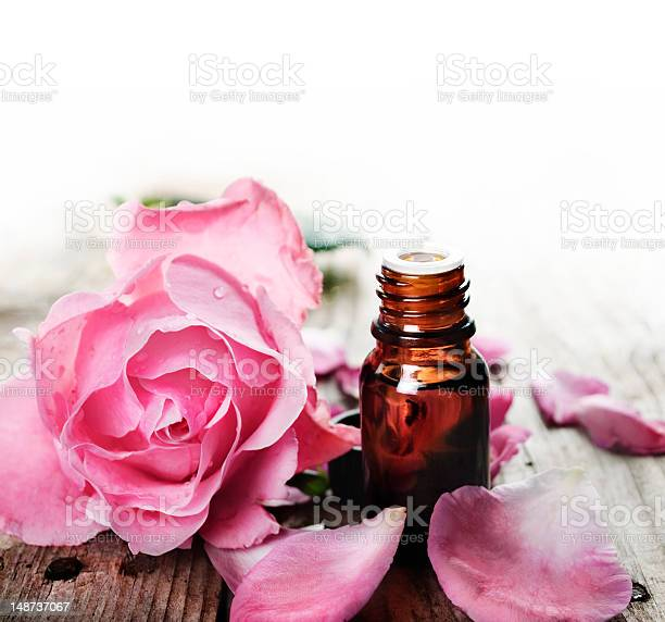 Essential oil with roses on a wooden table picture id148737067?b=1&k=6&m=148737067&s=612x612&h=xzkyve226ejeqobr c9qhu9i0 gonaapebn1jhrt ji=