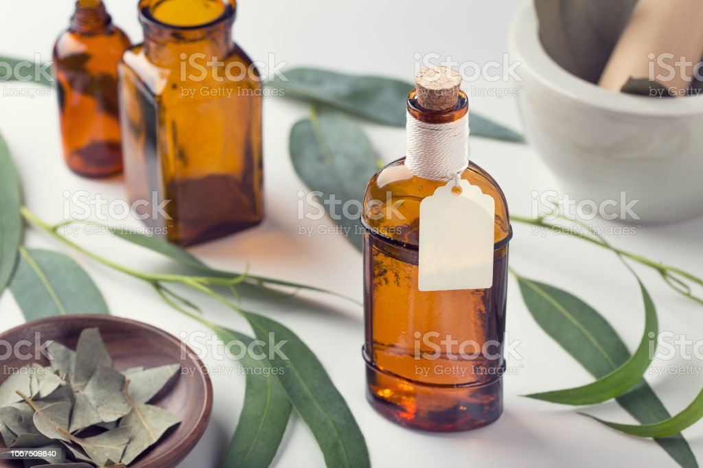 Essential oil with tag. Eucalyptus oil. Mock up stock photo