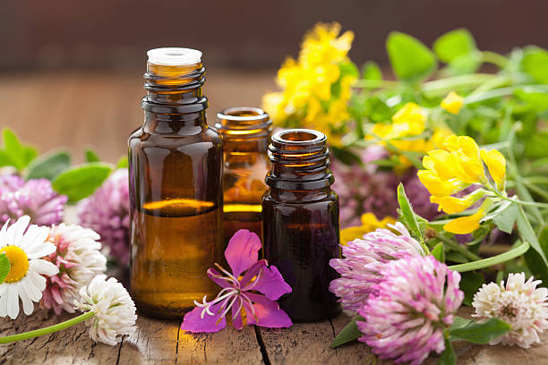 essential oils and medical flowers herbs - aromaterapi stok fotoğraflar ve resimler