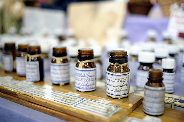 essential oils on a market stall - aromatherapy stock photos and pictures