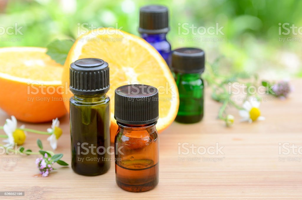 essential oils with fruits and herbs stock photo