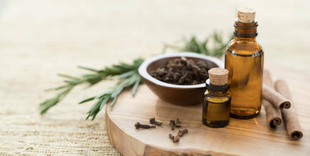 Essential Oils with Rosemary, Cloves & Cinnamon. stock photo