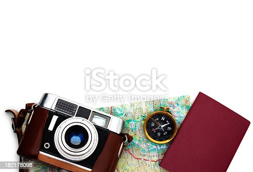 istock Essential travel equipments lying over white 182178098