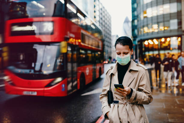 Essential worker in London with face mask going back home after work with face mask on stock photo