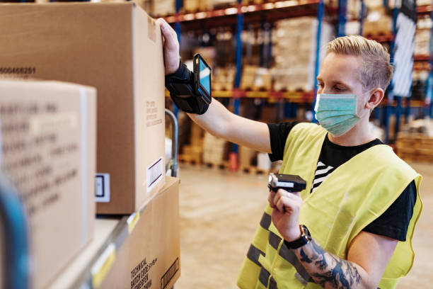 Essential workers in service and delivery industry with face mask during covid-19 pandemic stock photo