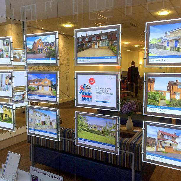 estate agency window display - store window stock pictures, royalty-free photos & images