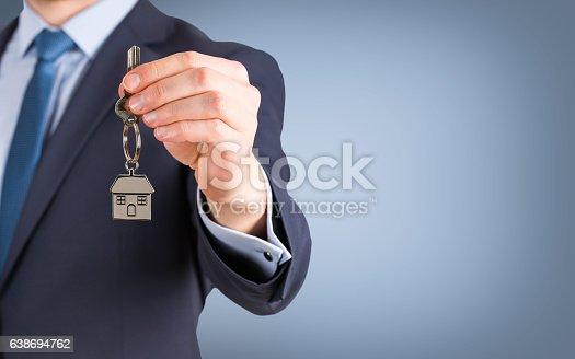 Estate agent giving house keys