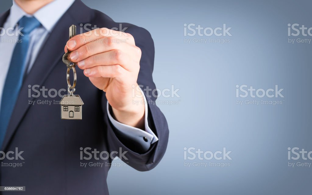 Estate agent giving house keys stock photo