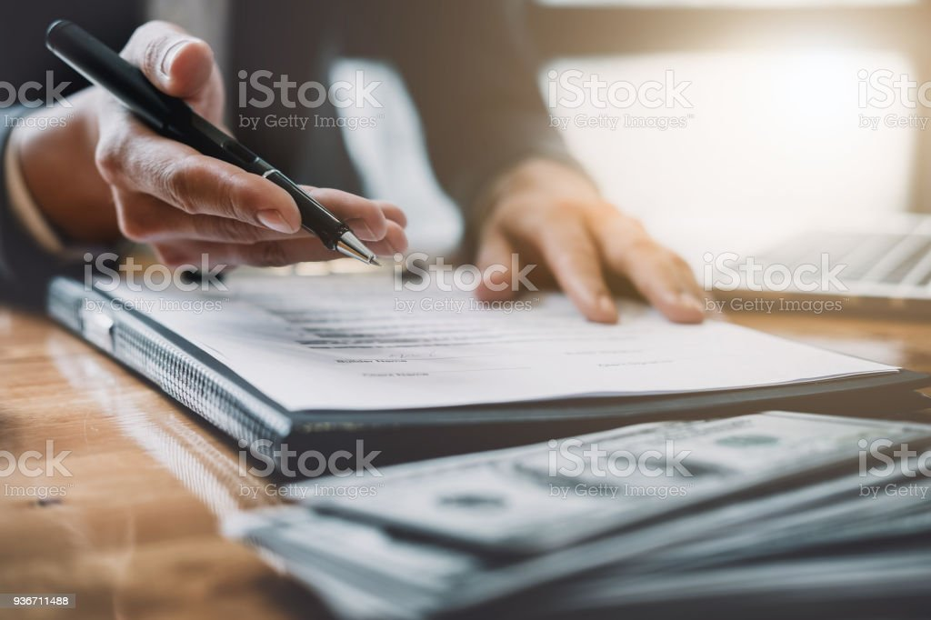 Estate agent need to sign agreement with his customer for rental house stock photo