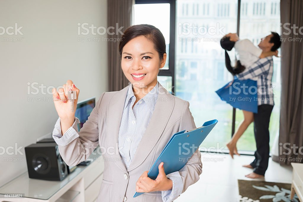 Estate agent with keys stock photo