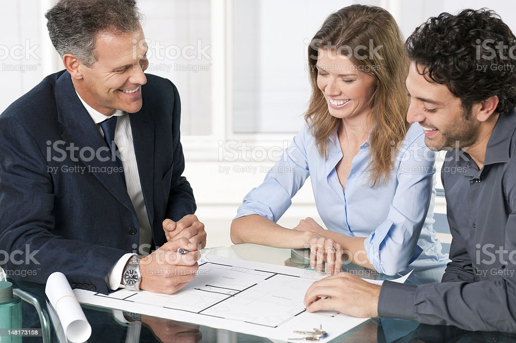 Estate agent with smiling couple stock photo