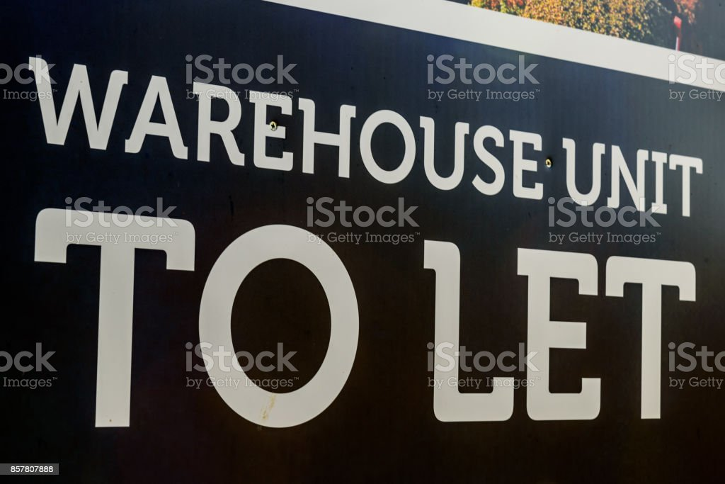 Estate agents industrial warehouse and office units to let sign stock photo