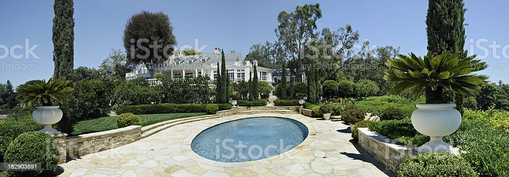 estate home with oval pool stock photo