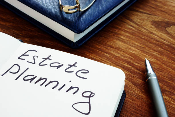Estate planning handwriting sign on the sheet. stock photo