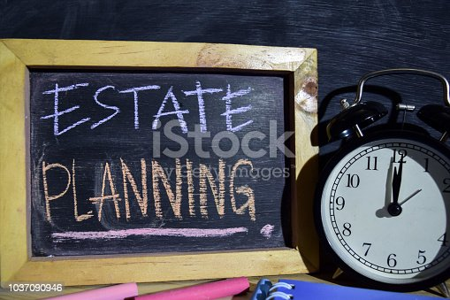 istock Estate Planning on phrase colorful handwritten on blackboard 1037090946