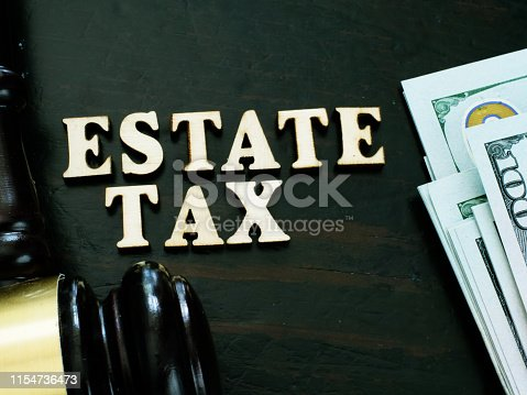 Estate tax from wooden letters and gavel.