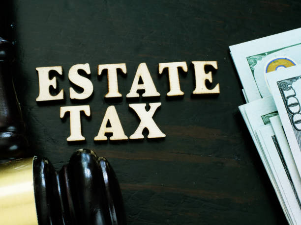 Estate tax from wooden letters and gavel. Estate tax from wooden letters and gavel. grounds stock pictures, royalty-free photos & images
