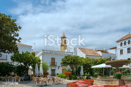 A pretty plaza in the centre of the old town of Estepona, on the Costa del Sol, near Marbella, Spain. A popular place for tourists where each of the narrow streets of the old town is characterised by plant pots of a dufferent colour.