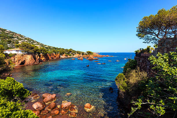 Esterel rocks beach coast and sea. Cote Azur, Provence, France. Esterel mediterranean red rocks coast, beach and sea. French Riviera in Cote d Azur near Saint Raphael, Provence, France, Europe. var stock pictures, royalty-free photos & images