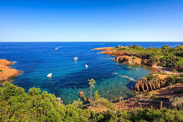 Esterel rocks beach coast and sea. Cote Azur, Provence, France. Esterel mediterranean red rocks coast, beach and sea. French Riviera in Cote d Azur near Cannes, Provence, France, Europe. var stock pictures, royalty-free photos & images