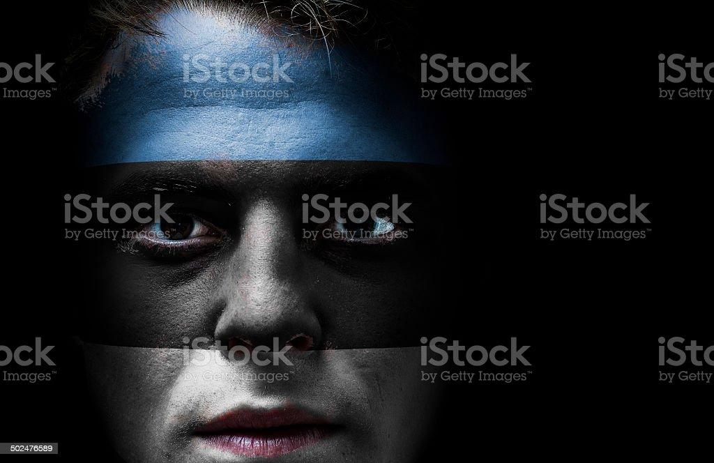 Estonia, Estonian flag on face royalty-free stock photo