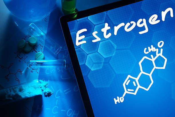 estrogen Tablet with the chemical formula of estrogen. Test tubes, tablets and chemical formulas. oestrogen stock pictures, royalty-free photos & images