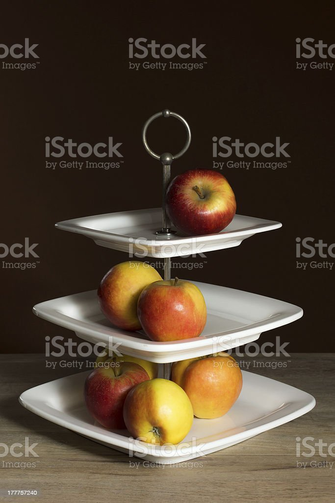Etagere with fresh apples stock photo