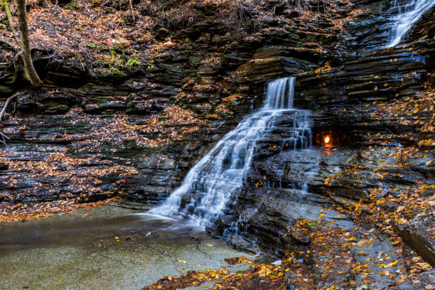 Eternal Flame and waterfall stock photo