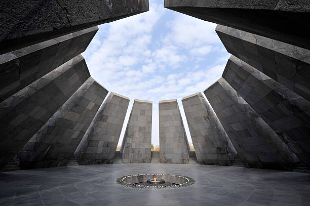 "Eternal flame in Tsitsernakaberd memorial ""Yerevan, Armenia - October 28, 2009. Eternal flame in Tsitsernakaberd. Tsitsernakaberd is a memorial dedicated to the victims of the Armenian Genocide in 1915. Yerevan, Armenia. The eternal flame inside the memorial."" armenian genocide stock pictures, royalty-free photos & images"