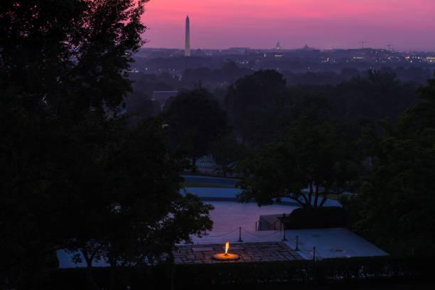 Eternal Flame of John F. Kennedy's Gravesite at Sunrise stock photo