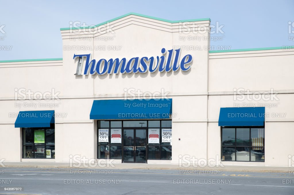 Ethan Allen store exterior and logo. Thomasville Furniture Industries...