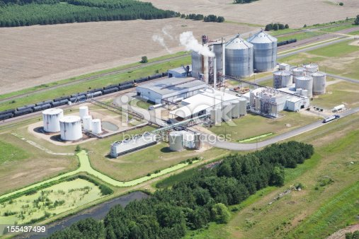 An Ethanol plant shot from the open window of a small airplane on an early summer day. 