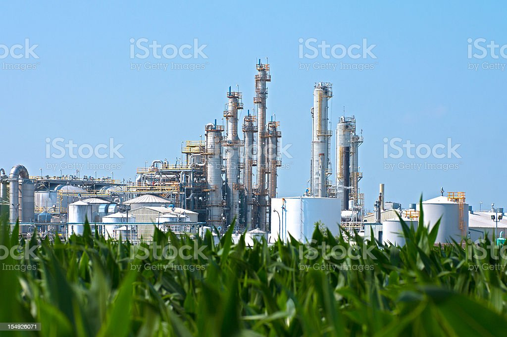 Ethanol Plant by Corn Field stock photo