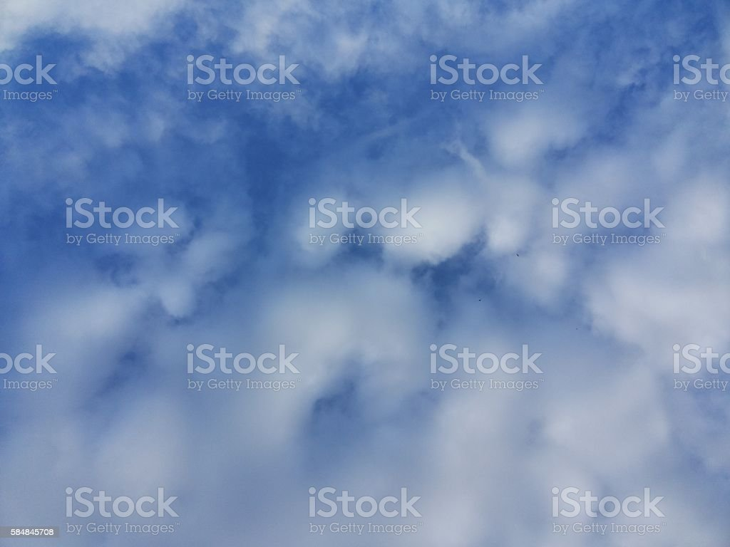 Ethereal fluffy small cirrostratus stock photo