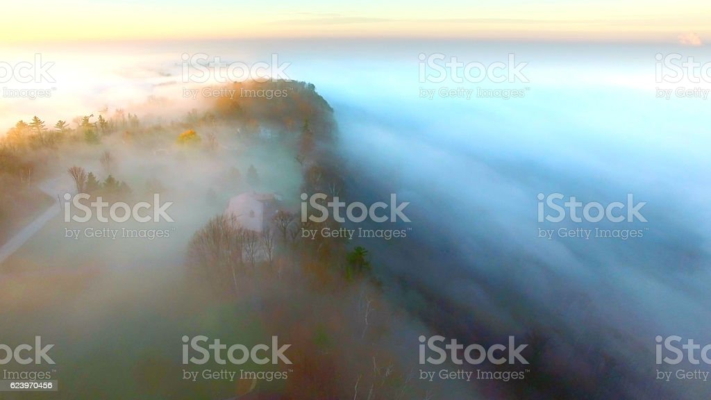 Ethereal foggy cliff at the edge of the world, stock photo