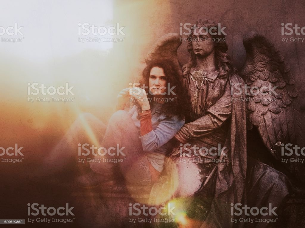 Ethereal Guardian Arch Angel Statue Holding Protecting Dark Hair Woman stock photo