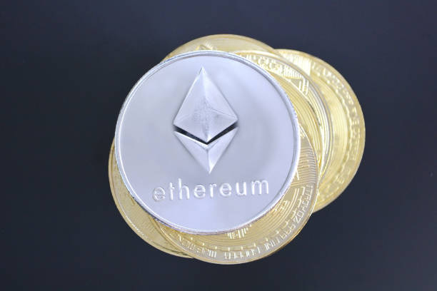 Ethereum on a pile of other cryptocurrency altcoins. stock photo