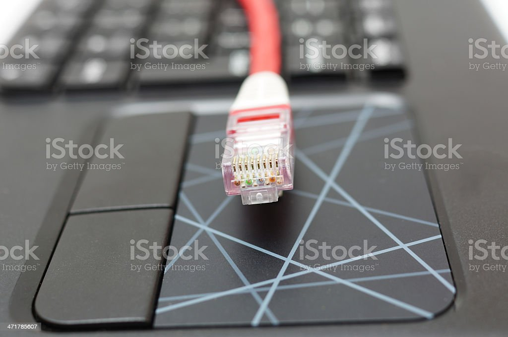 ethernet cable on touchpad royalty-free stock photo