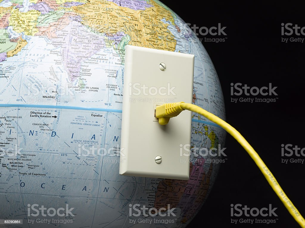 Ethernet cable pluged into globe  Black Background Stock Photo