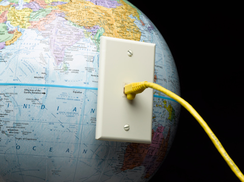 Ethernet Cable Pluged Into Globe Stock Photo - Download Image Now