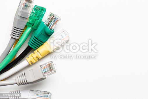 Network ethernet cables with RJ45 connectors on the white background.